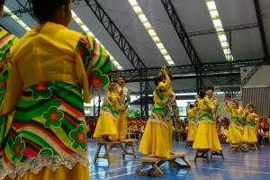 """Students of Xavier University-Ateneo de Cagayan perform """"Sayaw sa Bangko,"""" a Filipino folk dance which originated from Lingayen and Pangasinan, during their annual Physical Education culmination night on Saturday. The event aims to inculcate appreciation of Filipino culture to the people of Cagayan de Oro.(MNS photo)"""