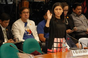 RCBC –Jupiter Branch Manager Maia Santos-Deguito takes an oath before testifying during a Senate hearing on the US$81 million money-laundering scandal, at the Philippines Senate on Tuesday. Deguito was summoned to shed light on the Philippines' biggest anti-money laundering case involving money stolen from the central bank of Bangladesh.(MNS photo)