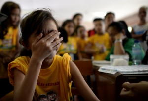 A student reacts before a nurse administers the anti-dengue vaccine at Parang Elementary School in Marikina.© AFP PHOTO/NOEL CELIS