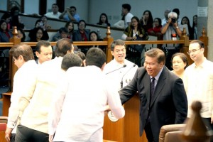 SENATE'S CLOSING MESSAGE FOR 16th CONGRESS: Senate President Franklin M. Drilon is congratulated by his fellow senators after delivering the Senate's closing message for the 16th Congress, which adjourned sine die during Monday's session, June 6, 2016. A four-time Senate President, it was Drilon's ninth time to deliver the closing message of the Senate. Those greeting Drilon, are clockwise, Senators Bam Aquino, Sonny Angara, Senate Deputy Minority Leader Tito Sotto III, along with Senators Gringo Honasan II, Antonio Trillanes IV, Koko Pimentel III, Cynthia Villar and Senate Majority Leader Alan Peter Cayetano.(MNS photo)