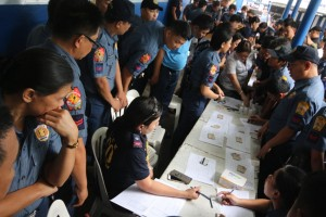 "The Quezon City Police District (QCPD) conducts another surprise ""urine"" drug test at Camp Karingal in Quezon City on Monday. The test was part of the new Philippine National Police leadership's efforts to cleanse the police ranks of scalawags.(MNS photo)"