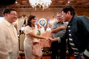 President Rodrigo R. Duterte welcomes Vice President Maria Leonor V. Robredo who was appointed secretary of the Housing and Urban Development Coordinating Council (HUDCC) prior to the Cabinet meeting in Malacañan Palace on July 11, Monday.(MNS photo)