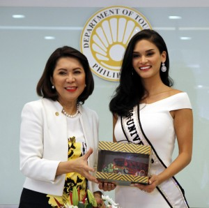 "Miss Universe Pia Alonzo-Wurtzbach visits the new Department of Tourism Office: Miss Universe Pia Alonzo-Wurtzbach receives a token of appreciation from Department of Tourism (DOT) Secretary Wanda Corazon Teo during the former's visit at the new DOT Headquarters along Sen. Gil Puyat Ave. in Makati City on Monday (July 18, 2016). In a press conference after their meeting, Secretary Teo said she is grateful for the full support the reigning Miss Universe is giving to DOT's efforts to host the upcoming Miss Universe contest in the country. ""We are really hopeful that President Rodrigo R. Duterte will grant our request, especially now that this undertaking would practically entail no expense on the part of government. More importantly, it would give a big boost to businesses and livelihood of millions of people, in line with our 'shared tourism' program,"" the DOT Chief said. (PNA photo by Jess M. Escaros Jr.)"