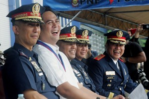 """Presidential Communications Office (PCO) Secretary Martin M. Andanar (second to the left), Police Director General Ronald M. Dela Rosa (center), and other Philippine National Police (PNP) generals during the launching of """"PO1 Bato"""", a mascot depicting the PNP chief, on Monday (August 1, 2016), coinciding the 24th Police Community Relations Group Founding Anniversary at National Headquarter Philippine National Police (NHQ, PNP), Camp Crame in Quezon City. (MNS photo)"""