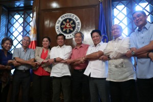 President Rodrigo R. Duterte, members of the Government of the Philippines (GPH) Peace Panel, and members of the National Democratic Front (NDF) Peace Panel join hands at the President's Hall in Malacañan Palace on August 15.