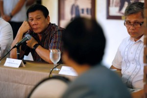 President Rodrigo Roa Duterte listens to social welfare secretary Judy Taguiwalo during a briefing on the effects of Southwest Monsoon on August 15, 2016 at Bahay Malago, Malacañang Compound, Manila City.(MNS photo)