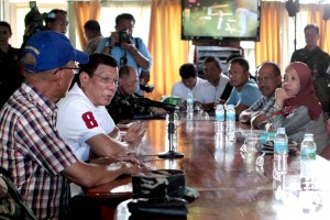 President Rodrigo R. Duterte holds a meeting with local officials at the 104th Brigade Camp in Isabela City, Basilan on July 21. (MNS photo)