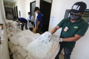Philippine Drug Enforcement Agency (PDEA) operatives conduct an inventory of ingredients used in the manufacture of illegal drugs at the Henson Plastic factory warehouse in Valenzuela City on Friday. PDEA agents raided the alleged shabu laboratory and confiscated an undetermined amount of ingredients used to make shabu.(MNS photo)
