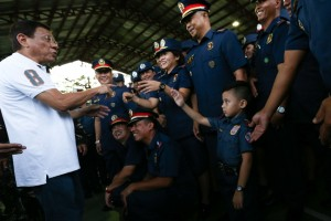 Four-year-old Allih Hachaso, son of Police Officer 3 Eric Hachaso, gives President Duterte a snappy salute as the latter talks to members of the Philippine National Police at the Southern Luzon Command Headquarters in Camp Guillermo Nakar, Lucena City on Thursday.(MNS photo)