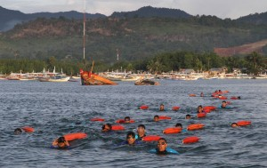 1.5 km. Swim for Lifeguard Licensed Training: Some 28 participants for the lifeguard licensed training swim the final endurance for 1.5 km. – from Honda Bay Pier up to the Cowrie Island – for the 12 days training on Monday (August 1, 2016). The course aims to equip the lifeguards in the region with the necessary knowledge about water safety and rescue which can prevent water incidents like drowning. It is sponsored by the Department of Health-MIMAROPA Region in close partnership with the Philippine Coast Guard and the Puerto Princesa City local government. (PNA photo by Roland Nablo)