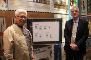 Mr. Ted Wilson (right) shows Mr. Roberto Mercado the Philippine stamps that were on display at the Postal Museum's William H. Gross Stamp Gallery.