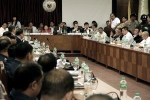 Department of Justice Secretary Vitaliano Aguirre II (left) asks questions to convicted drug lord Herbert Colangco (right), one of the high profile inmates at the New Bilibid Prison (NBP) testifying during the congressional inquiry on illegal drugs on Tuesday (September 20, 2016) at the House of the Representatives in Quezon City. The House committe gave the DOJ Secretary the permission to cross-examine witnesses on the alleged illegal drugs operation inside the detention center. Also in photo is Oriental Mindoro Representative Reynaldo Umali (middle), chairman of the House justice committee.  (MNS photo)